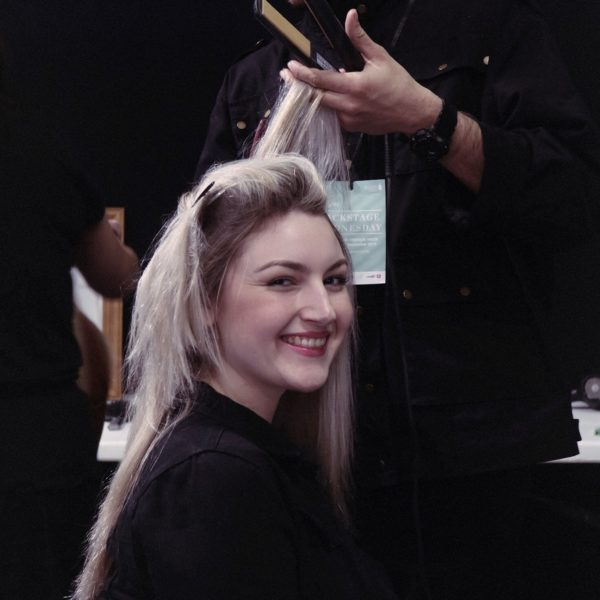 Blonde model gets hair straightened at NZFW 2018