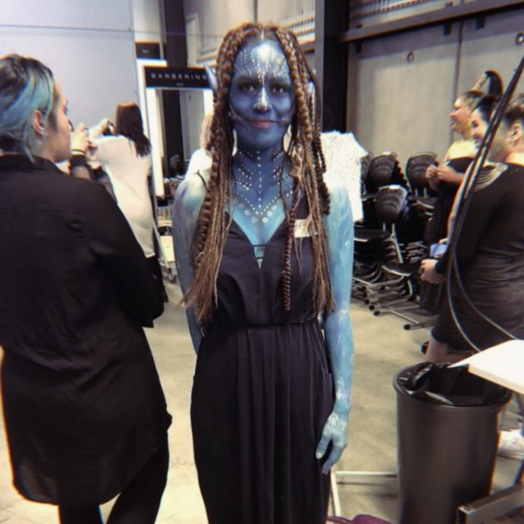 Female with blue avatar makeup and braids