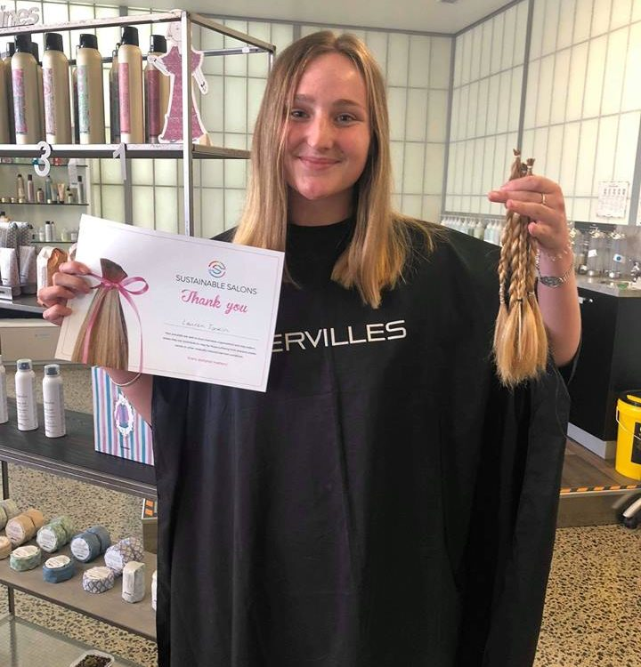 Girl poses with hair donated for charity
