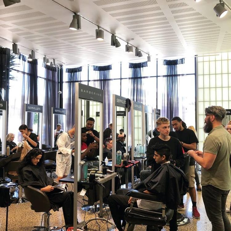 Barbering students in the Servilles Academy Salon