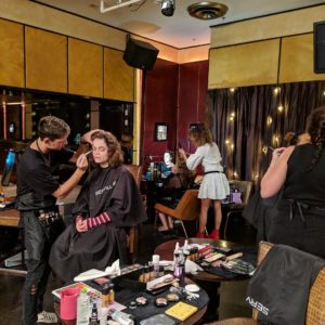 Three makeup students work at Charity Show in Sky City
