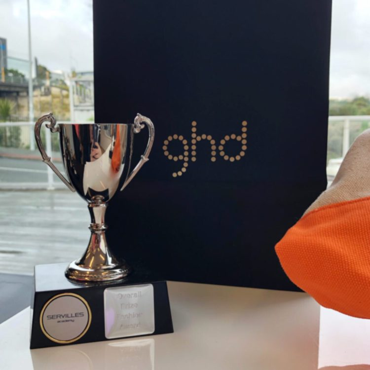 Servilles trophy in front of GHD