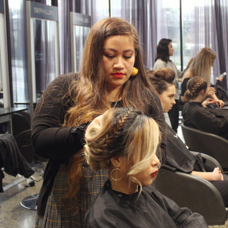 Hairdressing student creates braided look on model