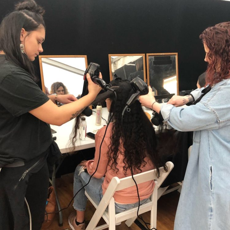 Hairdressing students style hair at NZFW2019