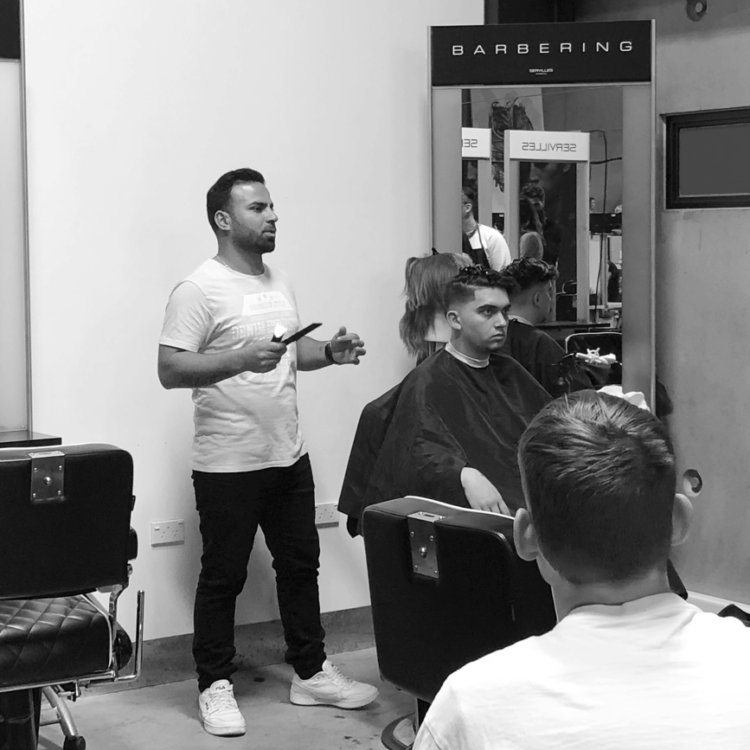 Barbering tutor Danny standing next to hair model