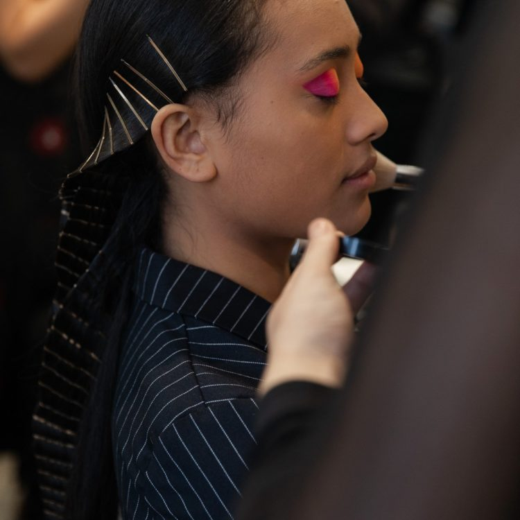 Young woman with clip hairstyle gets pink eyeshadow