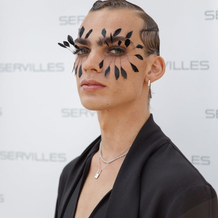 Young man with feather makeup