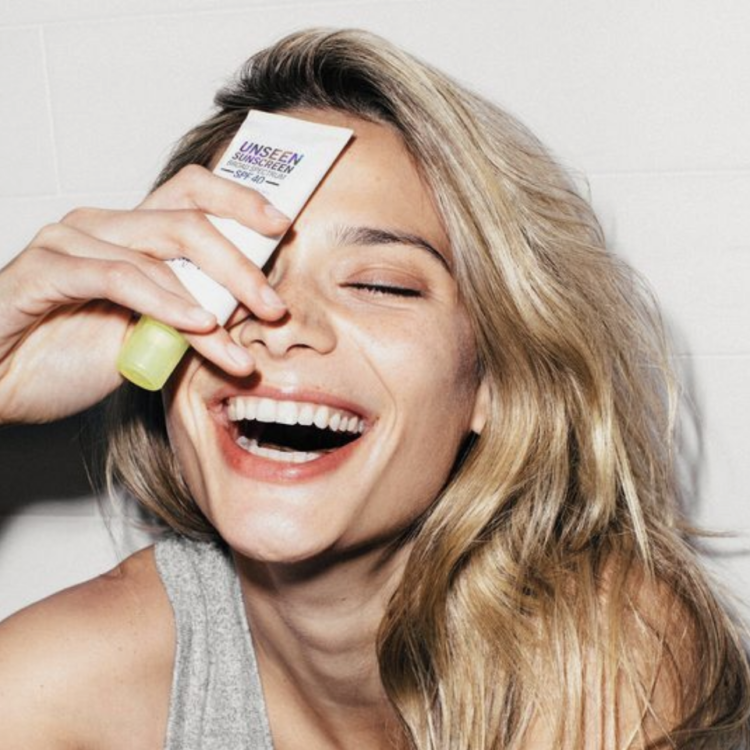 woman laughing skincare product