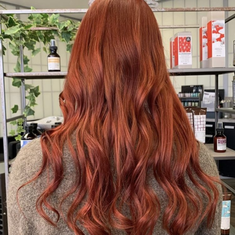 red copper hair client in salon